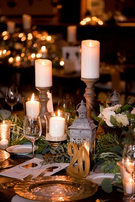 Wedding Reception Centerpieces With Lanterns In Candles On Stands Gold Table Number