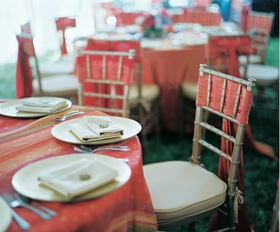 Red and orange tablecloth and chair cover
