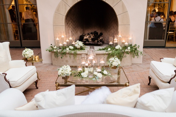the resort at pelican hill wedding reception, liunge area in front of fireplace, candles