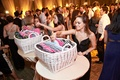 guests selecting from basket of flip flops for dancing at wedding