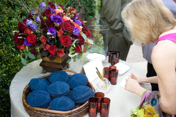 Garden Jewish ceremony yarmulkes on table