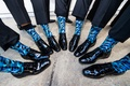 groom and groomsmen with crazy patterned blue socks