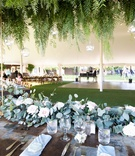 Echosmith singer Sydney Sierota and Cameron Quiseng wedding reception eucalyptus wood table ferns
