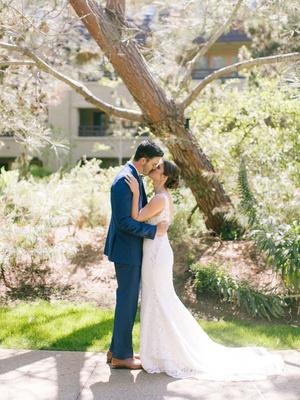 bride in wedding dress hair in low bun updo groom in navy suit brown shoes lodge at torrey pines
