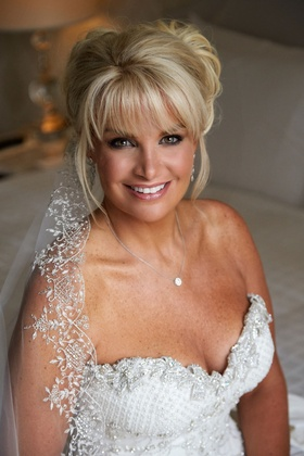 Bride in an Ines Di Santo dress with crystals, beading on bodice and veil, light lipstick, smoky eye
