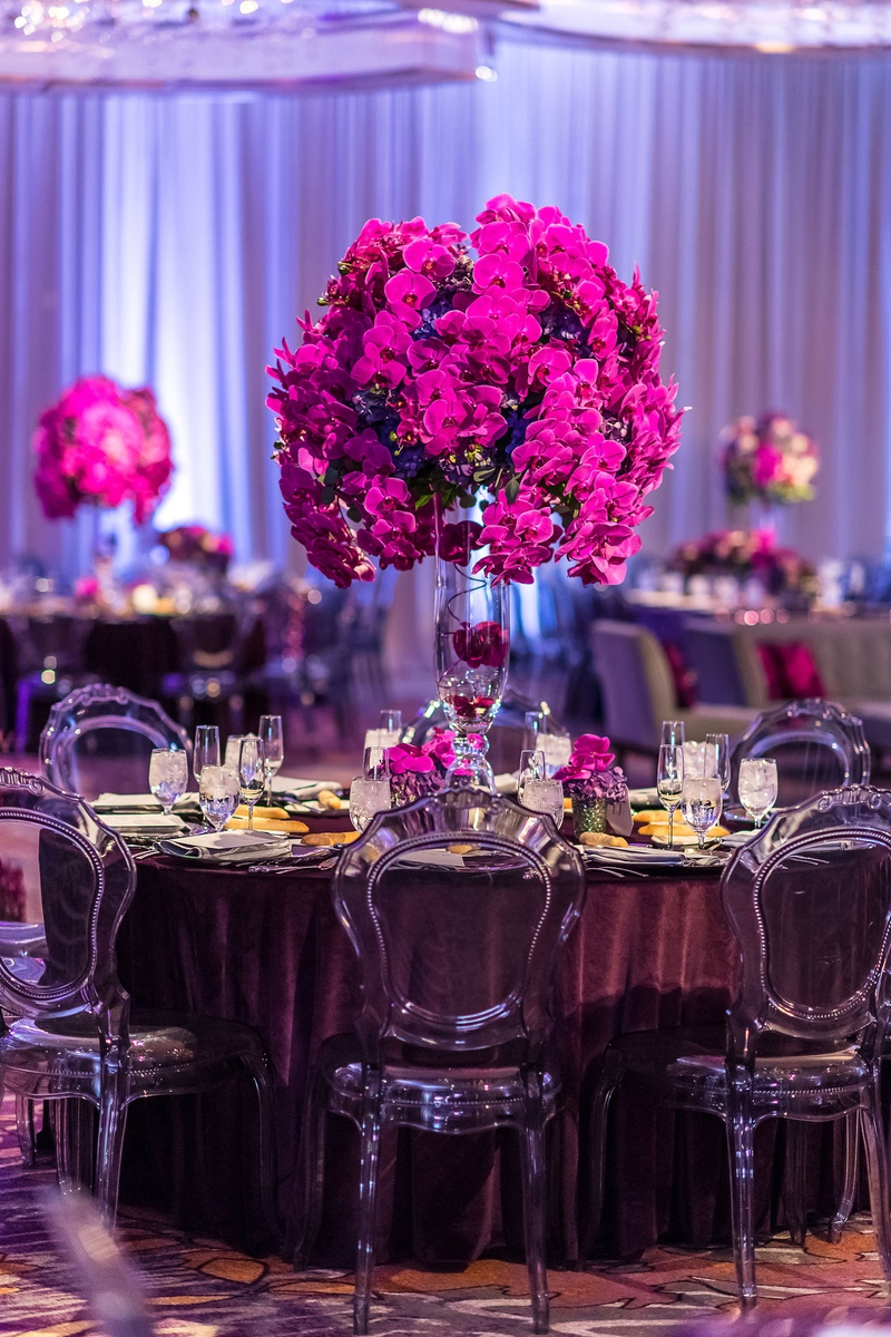 translucent smoke grey chairs, velvet eggplant linens, fuchsia orchids tall centerpieces