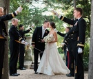 Navy military wedding bride and groom in tunnel arch of swords sabers wedding ceremony