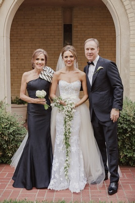 bride in mira zwillinger wedding dress with mark ingraham overskirt, mother in chic dress with bow