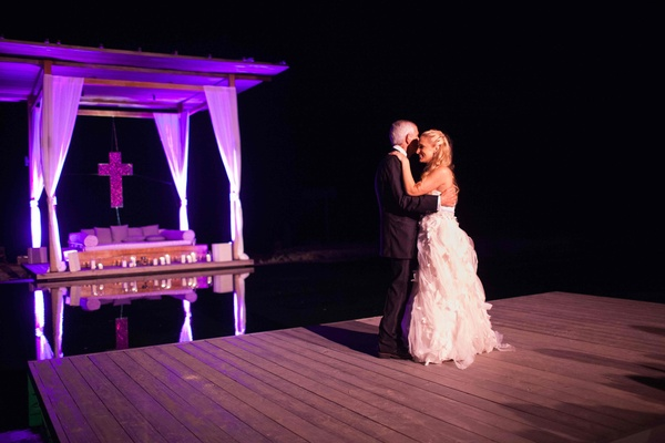 Poolside father and daughter wedding dance at reception