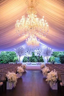 four seasons los angeles at beverly hills wedding ceremony chandelier drapery white trees cherry
