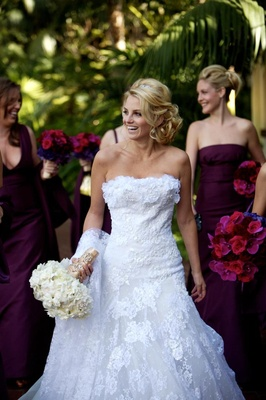 Bride in front of bridesmaids in white lace ruffle bodice