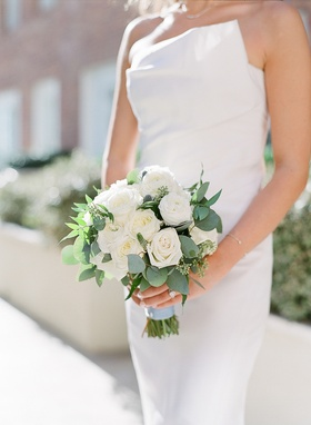 bridal bouquet with white roses and eucalyptus leaves, wrapped with pale blue ribbon