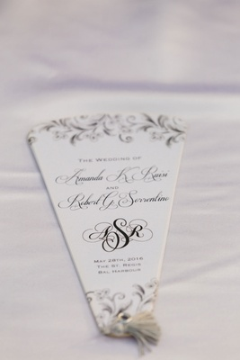 black-and-white ceremony fan with wedding information