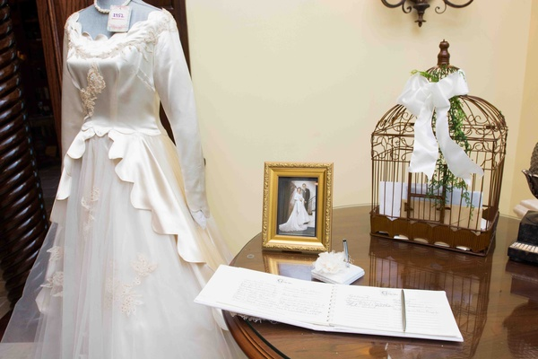 Guest book with antique wedding dress and family photo