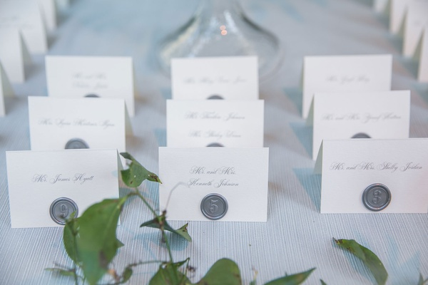wedding reception outdoor wedding white escort cards calligraphy silver grey wax seal on card