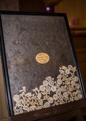 wood chips filling frame of wedding guest book