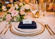 wedding reception place setting gold rim charger plate flower print place card with entree selection