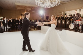 bride in mira zwillinger wedding dress with mark ingraham overskirt, groom in tux, fun first dance