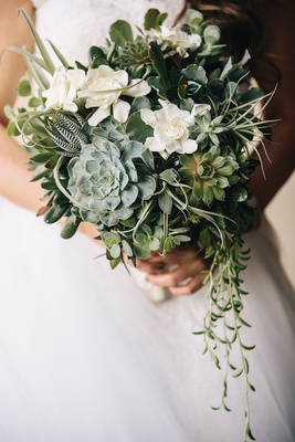 Rustic wedding bouquet with greenery, gardenia, feather, and succulents