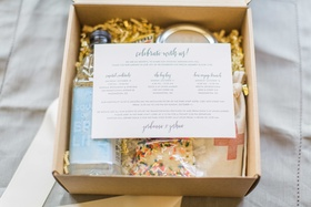 Celebrate with us welcome box water, cookie, emergency kit with itinerary for weekend