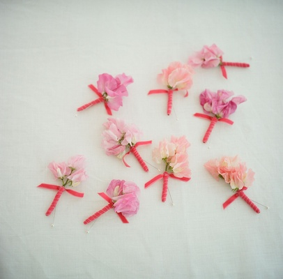Groomsmen flowers hand-tied with cerise ribbon