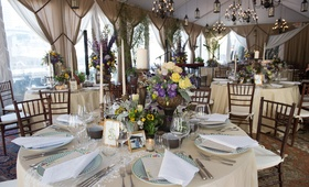 42f7013b467b champagne hued circular tablescape centerpiece purple yellow chandeliers  new york city skyline