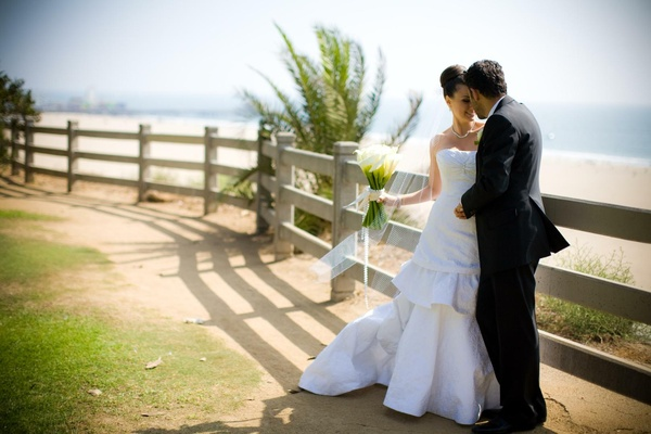 Bride and groom on pathway by beach