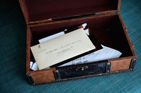 Wood box filled with letter and embroidered hankie