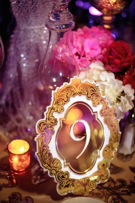 glam wedding reception pink red purple color palette gold ornate design cut out mirror laser cut