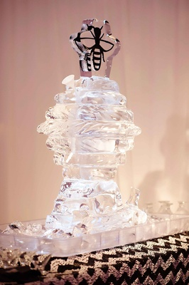Ice luge in shape of bee hive with bee topper