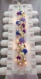 Bird's eye view of long white reception table