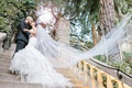 two tier cathedral veil blowing behind ride, veil shot wedding inspiration photos, bridal veil photo
