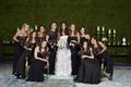 bride in oscar de la renta, bridesmaids in mismatched black dresses, moody dark bouquets