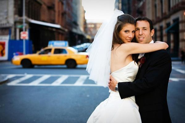 bride and groom hug on new york street