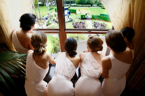 Bridal party watching ceremony setup