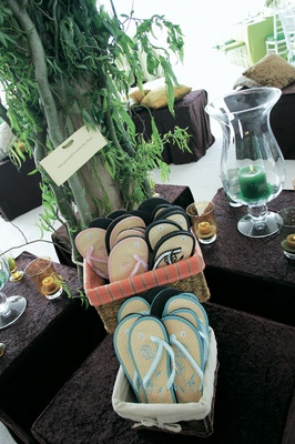 Black, pink, and blue flip-flops for women at wedding reception