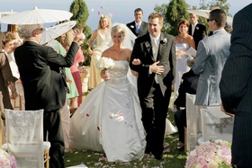 Isabelle Bridges and husband exiting ceremony