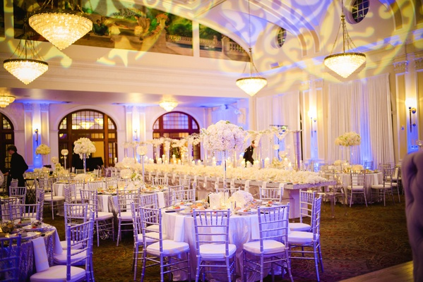 Purple lighting on white linens and tables
