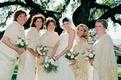Bride with five bridesmaids wearing tan ponchos