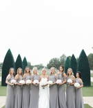 bridesmaids in grey dresses off the shoulder white nosegays to match the bride