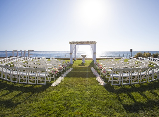 Destination Wedding In Mexico LOVE Marquee Sign And White Blush Flowers On Oceanfront Lawn At Estate