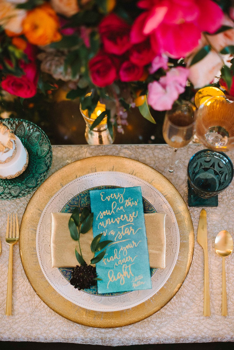gold and blue table setting wedding reception quote on charger plates