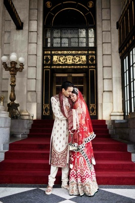 Indian couple in traditional attire outside The Plaza