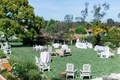 Green lawn at The Inn at Rancho Santa Fe decorated with rental furniture and tables