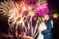 couple kissing underneath fireworks nighttime wedding hotel del coronado reception entertainment sky