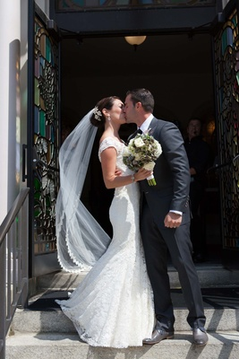 John Colaneri, co-host of Kitchen Cousins, kisses his bride at Jesus Saviour Church, Newport