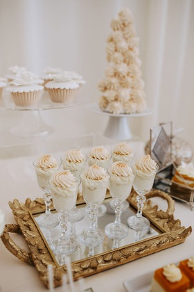 fall wedding ideas dessert table glasses filled with custard and meringue mirror gold ornate tray