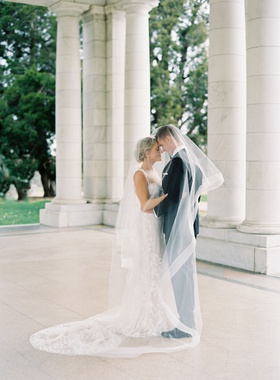 bride in berta wedding dress groom in tuxedo under veil with horsehair trim portrait wedding ideas