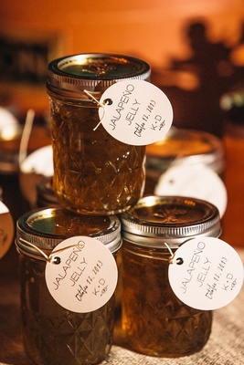 Mason jars filled with jalapeno jam with round card