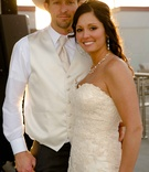 Shelly Bartels in Maggie Sottero wedding dress and Tyrel Nelson in white wedding attire
